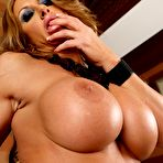 Fourth pic of Muscled Farrah Foxxx shows off big boobs and spreads stockinged legs thrusting her pussy on a dildo