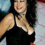Fourth pic of Busty Jennifer Tilly deep cleavage and areola slip