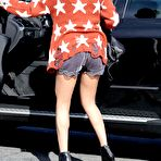 First pic of Selena Gomez leggy wearing shorts and ankle boots out in LA