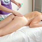 First pic of Young and busty Raquel is engaged in a happy ending oil massage
