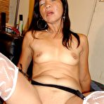 Third pic of Hot and sexy older Asian granny is black stockings ready for sex