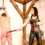Fourth pic of OWK - Mistress Taurea whipping her slave with riding crop