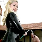Second pic of OWK - Mistress in black latex catsuit humiliates her slave