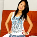 Second pic of Cute Thai newcomer model Pat stripping her denim shorts and top