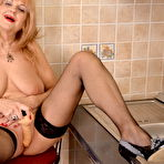 Third pic of mature lady playing in the kitchen