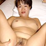 Fourth pic of Older Asian Milf getting naked for her first porn shoot