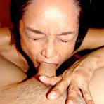 Third pic of Older amateur Asian granny getting nasty with her wet pussy and tight asshole