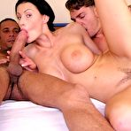 Third pic of Monsters of Cock - Brunette babe with big boobs sucking cocks and having interracial threesome for Monsters of Cock