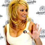 First pic of Pamela Anderson busty wearing a tight white dress at the 'Striplac' nail polish presentation in Dusseldorf