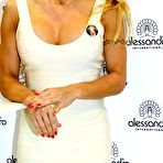 Second pic of Pamela Anderson busty wearing a tight white dress at the 'Striplac' nail polish presentation in Dusseldorf