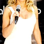 Third pic of Pamela Anderson busty wearing a tight white dress at the 'Striplac' nail polish presentation in Dusseldorf