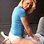 Third pic of Blonde in white panties and pink high heel shoes sits on man's face and smothers him