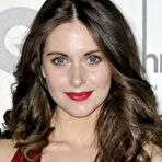 First pic of Alison Brie flashing her boobs braless in a low cut red dress at GQ Men of the Year Awards in London