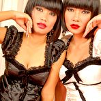 Fourth pic of Mintra and Nicha posing in lingerie playing with a dildo