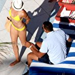 First pic of Cameron Diaz in yelow bikini relax in and by the pool