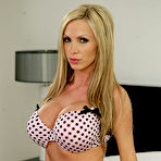 First pic of Nikki Benz - Nikki Benz strips her lingerie on the bed and gets her hungry vagina rammed hard.