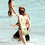 First pic of Lily Cole nipple slip on a yacht in St. Barts