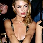First pic of Abigail Clancy nipple-slip in a low cut partially see-through dress at Julien Macdonald's London Fashion Week