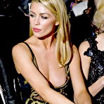 Second pic of Abigail Clancy nipple-slip in a low cut partially see-through dress at Julien Macdonald's London Fashion Week