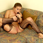 Fourth pic of Rita Faltoyano - Busty tanned brunette Rita Faltoyano in torn stockings showing sexy ass and cunny