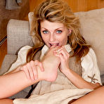 Third pic of Blonde teases by flashing her sexy panties and playing with her feet - XBabe