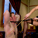 First pic of Domme Penny Flame dressed in sexy lingerie spanks her slave Angel then fucks him hard with strapon