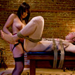 Fourth pic of Domme Penny Flame dressed in sexy lingerie spanks her slave Angel then fucks him hard with strapon