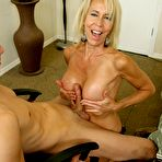 Fourth pic of Erica Lauren - Blond MILF jacking off a cock on Over40Handjobs.com