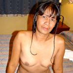 First pic of Mature Asian tramp Lisa takes off all her cloths and gets naked showing ass and pussy