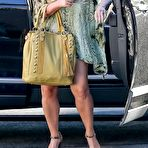 First pic of Jessica Simpson cleavy and leggy wearing snake print shirt and denim shorts out in Calabasas