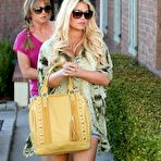 Second pic of Jessica Simpson cleavy and leggy wearing snake print shirt and denim shorts out in Calabasas