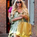 Fourth pic of Jessica Simpson cleavy and leggy wearing snake print shirt and denim shorts out in Calabasas