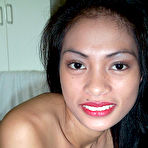 Second pic of Horny young Filipina chick spreading legs in white stockings