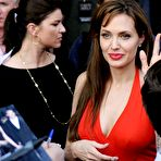 Second pic of Angelina Jolie in red dress at Salt premiere In Moscow