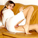 Second pic of Katrina Nubiles - Katrina Nubiles takes her white skirt off on the couch and shows her tight butt.