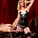 Third pic of Mona Wales give slave boy Brock Avery more than he bargained for in her Electro Femdom Dungeon.  Relishing in his pain, Mona tazes, zaps and cattle prods her slave after threatening his cock and balls with the violet wand.  She then teases him to the point of torture with an  electro dildo and strap-on.  Brock begs to come after trampling, foot worship and a multi-orgasmic face sitting.