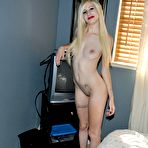 Fourth pic of Shy nude goth teen poses in a sleazy hotel room for her boy friend.