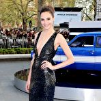 Second pic of Gal Gadot braless showing huge cleavage in a shiny black dress at Fast And Furious 6 premiere in London