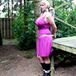 Fourth pic of Bondage Pictures - DeeDee pole-tied cleavegagged outside