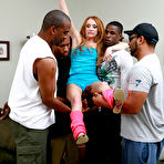 First pic of GangBang Squad - Redhead whore licking many cocks and having interracial sex until a cumshot for GangBang Squad