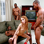 Fourth pic of GangBang Squad - Redhead whore licking many cocks and having interracial sex until a cumshot for GangBang Squad