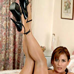 First pic of MILF in shiny seamless pantyhose and high heels on the bed