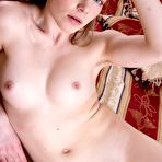 Fourth pic of Amber S undresses across her red bed seductively