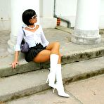 Second pic of Public escapades of a brune slut in pantyhose and glam boots