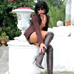 Third pic of Public escapades of a brune slut in pantyhose and glam boots