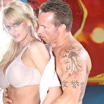 Third pic of Cute four-eyed blonde Stormy Daniels has her mouth and pussy packed by tattooed guy