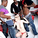 Third pic of Busty nurse Kristy Snow gives these three black guys the most thorough physical ever