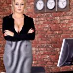 First pic of Busty Office Babe Shows Cleavage