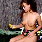 Third pic of Horny Judit ALS is getting special pleasure feeding pussy with banana in the open air