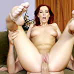 Fourth pic of Shaved Redhead Stella Red removes her red bikini to enjoy pussy pounding